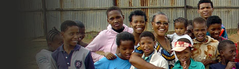 Rebecca Tsiane and the childrem of the Thusong Children's Centre